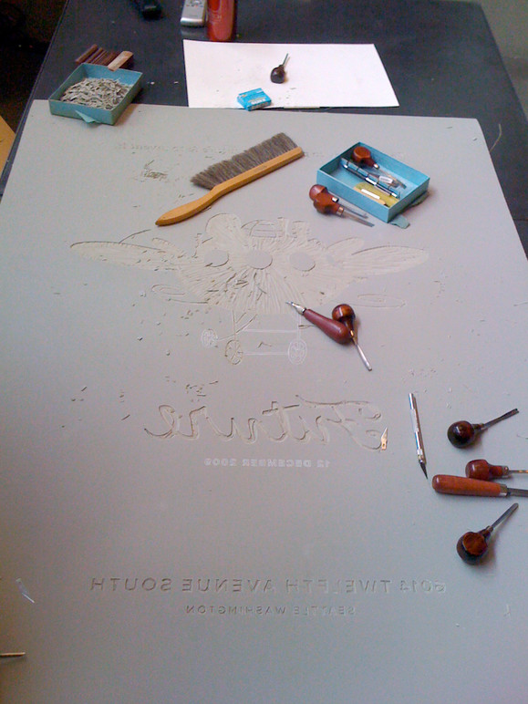In-progress of carving the large-scale linoleum plate used to print the poster.
