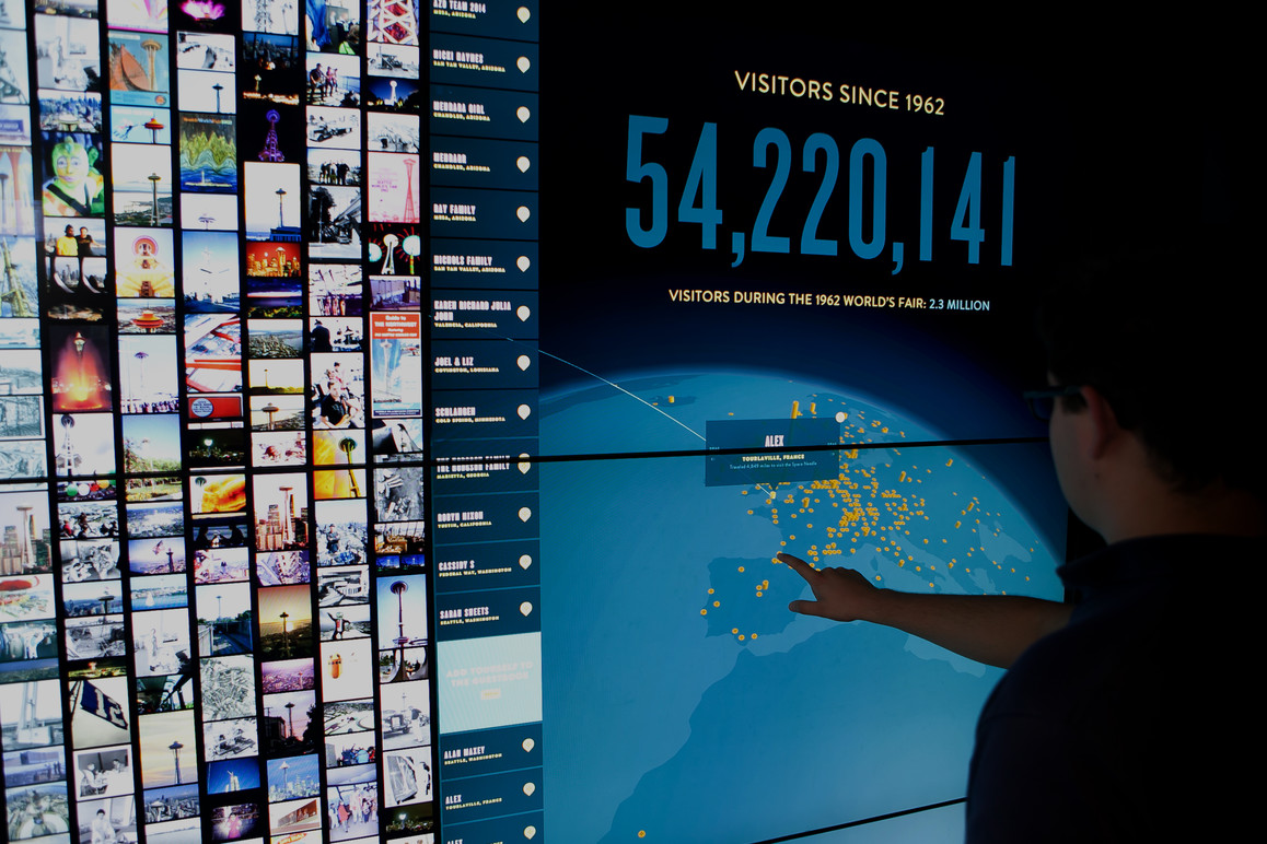 The visitor's name has been added to the map along with the number of miles they travelled to be at the Space Needle.