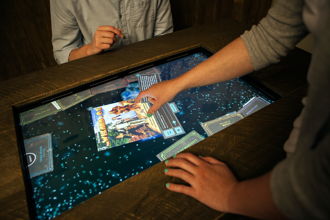 Wizard interactive in the exhibit space. Here, users can open magical books that contain videos, audio, images and text where they can learn more about the fantasy genre.
