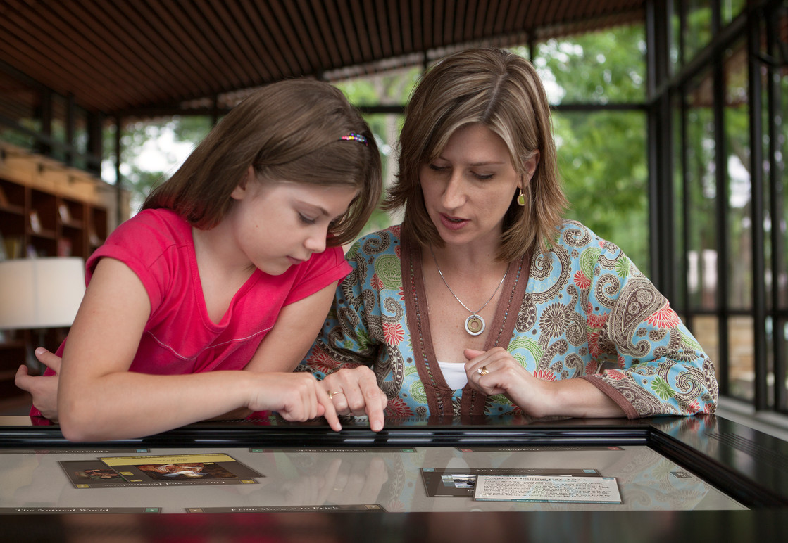Visitors using the Collection View Touchtables.