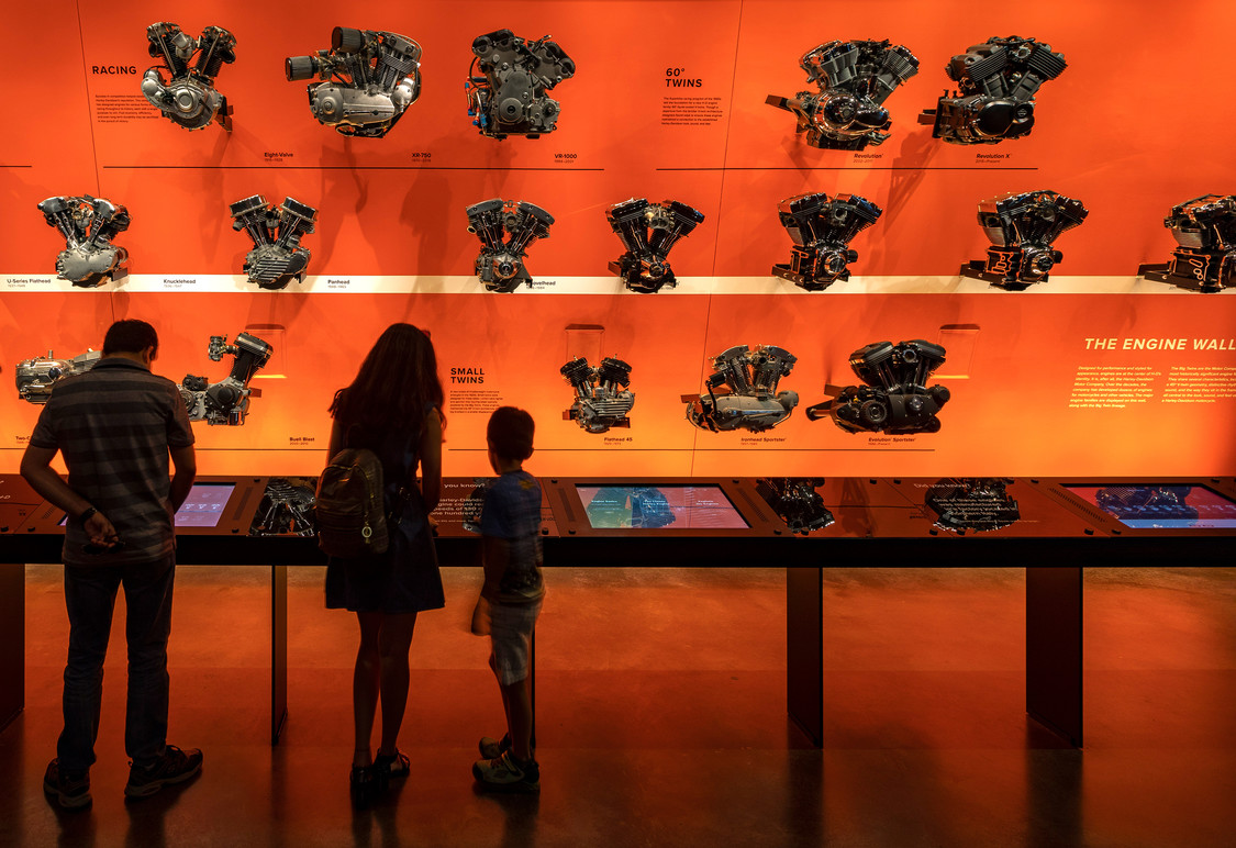 Visitors using Engine Wall interactives