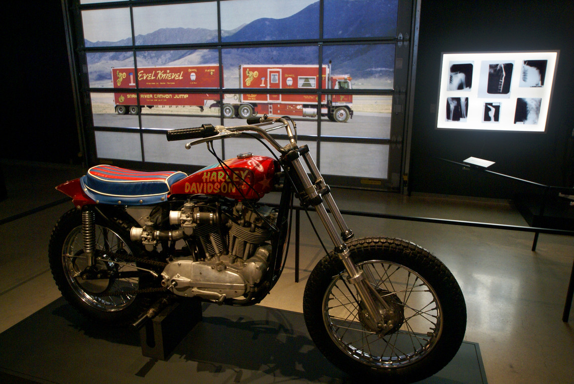 Key motorcycle along with illuminated garage door graphics and collection of x-rays of bones that Evel had broken.