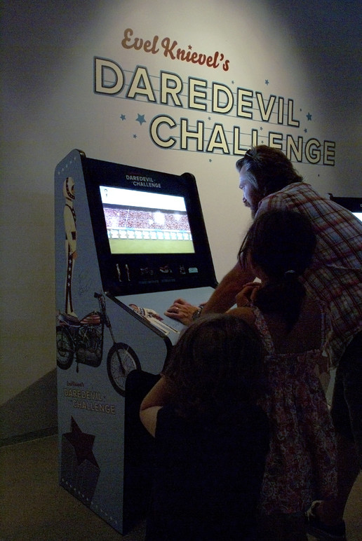 Evel Knievel's Daredevil Challenge, a 1970s inspired arcade game developed in parallel with the exhibition, where players can compete for the longest and most dangerous jump.